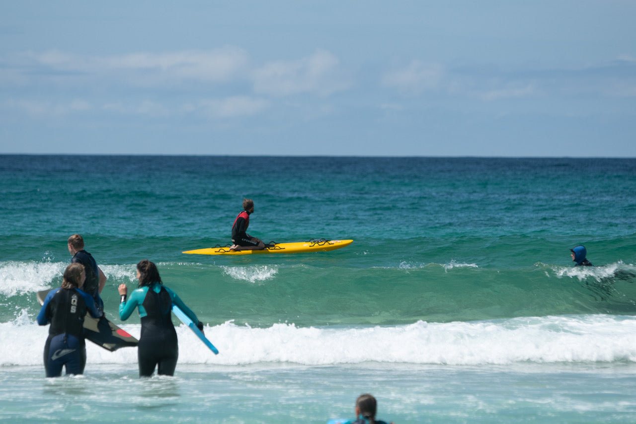 Finisterre Ambassador Mike Lay sits in the line up on a rescue board keeping a watchful eye on bathers
