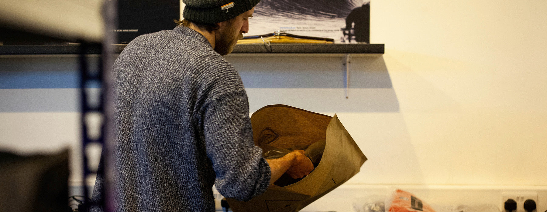 Jack packing orders in the Finisterre warehouse