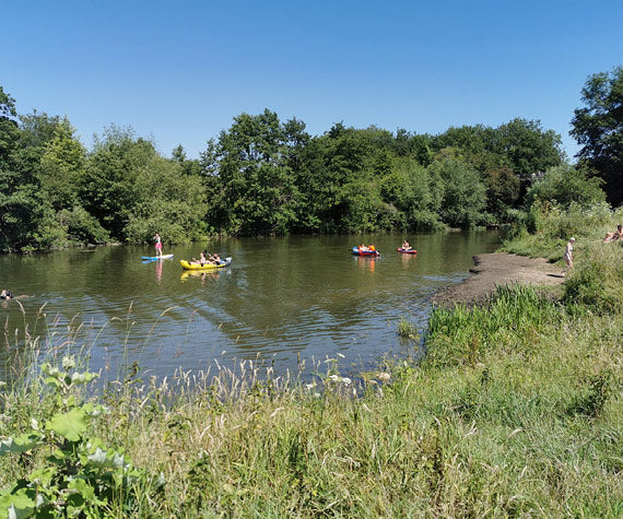 Swimmers and kayakers on the River Avon