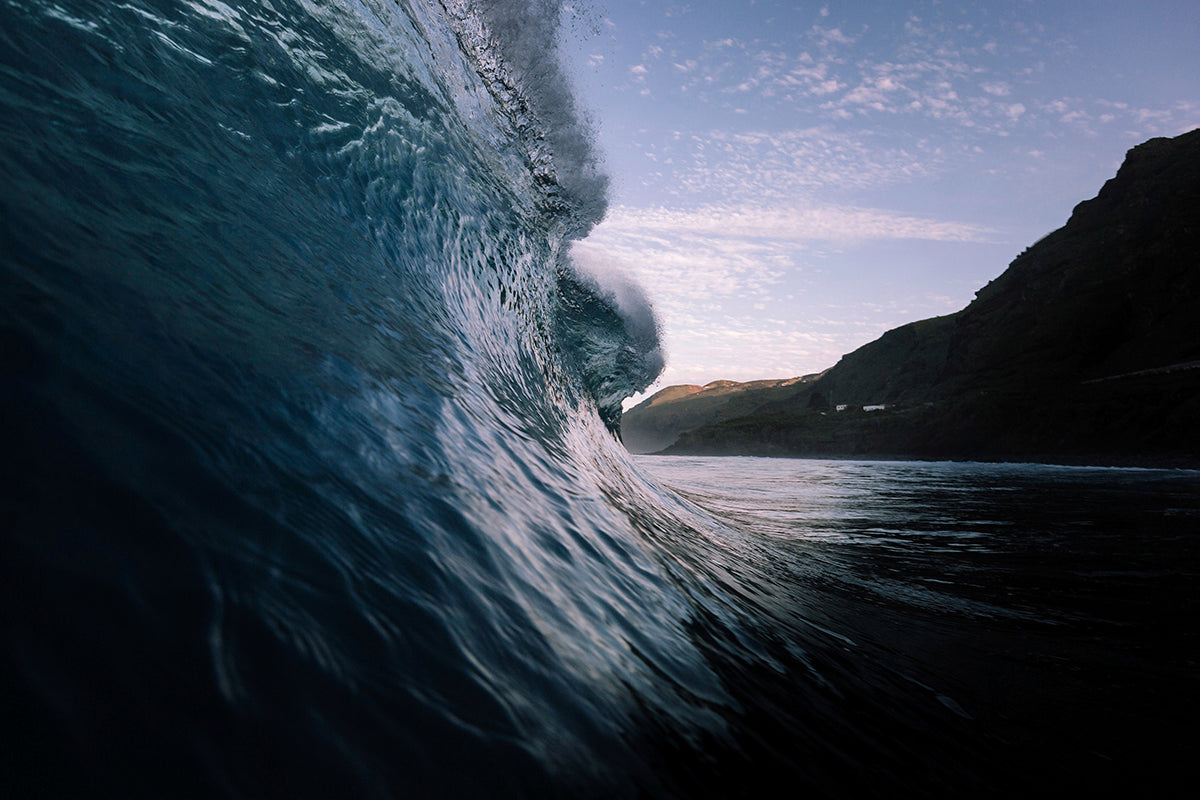 Looking down the line on an empty cresting wave
