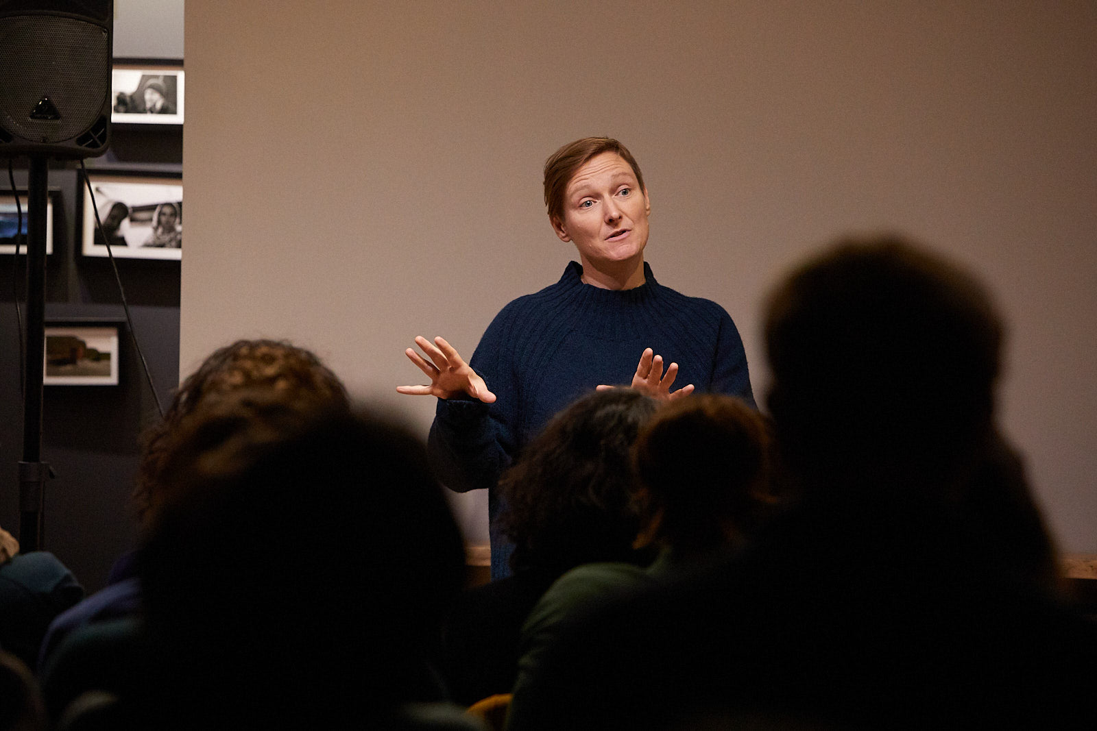 Beth French stands in front of the crowd at a screening of Against The Tides in Finisterre's store