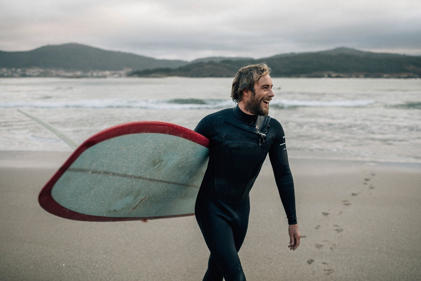 The Author, Mike Lay, grinning from ear to ear as he emerges from a satisfying surf