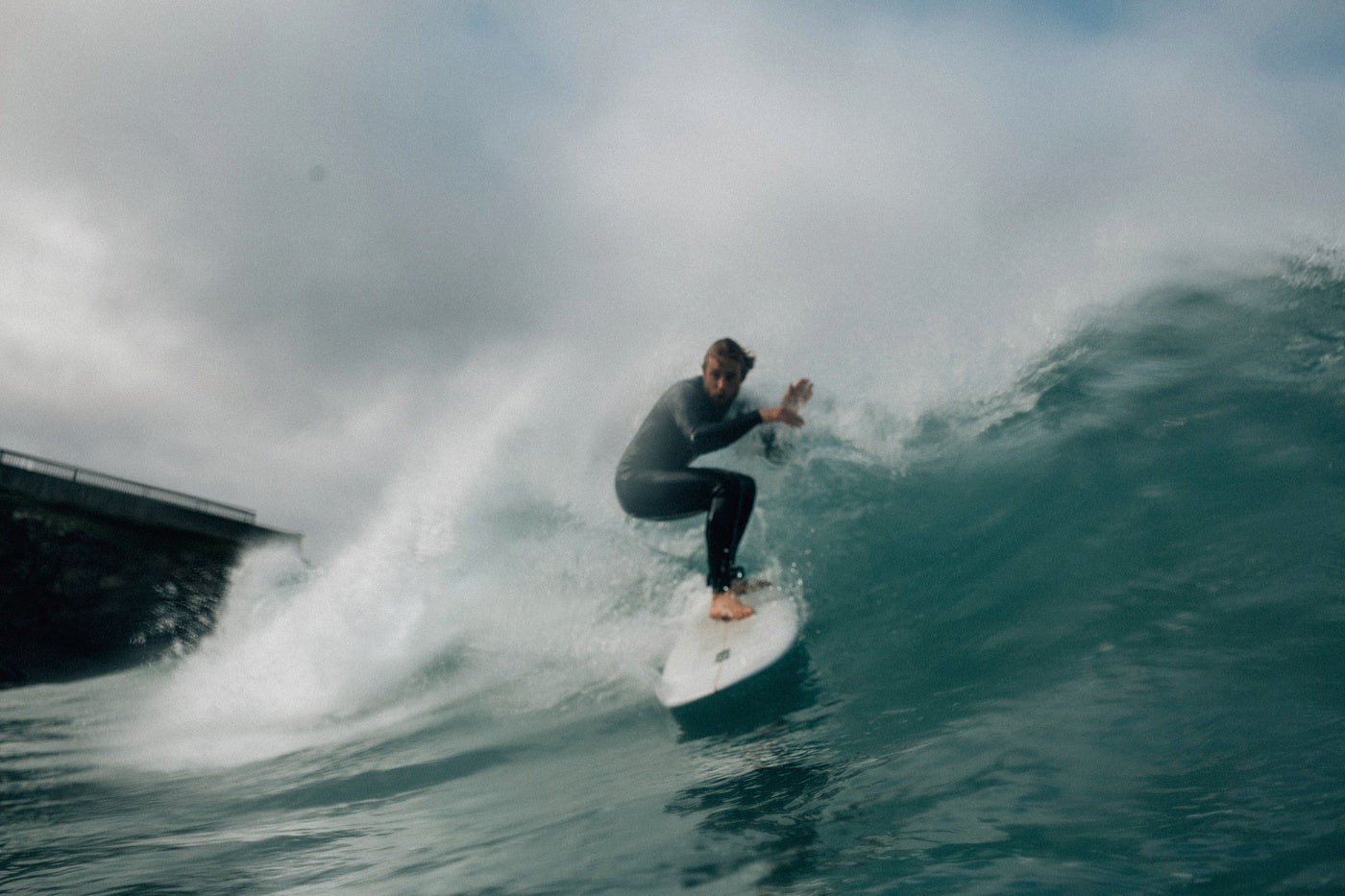 The lip of a wave crashes onto Mike but he stays firmly on his feet