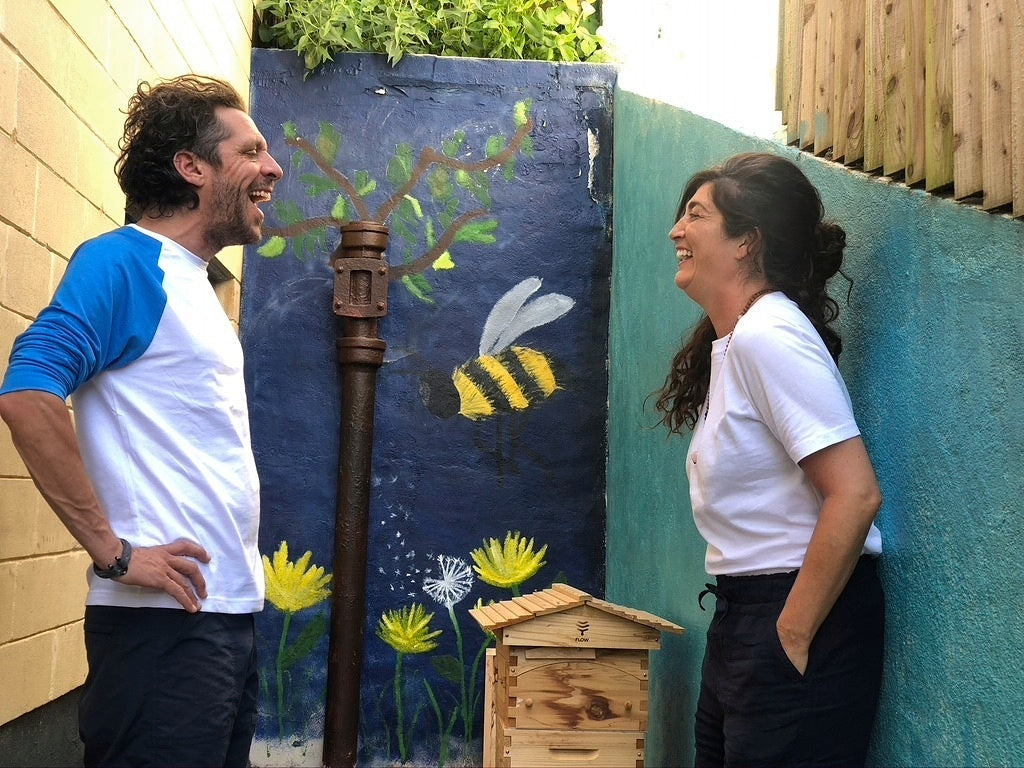 Dan and Seemah Burgess share a laugh by the newly constructed beehive