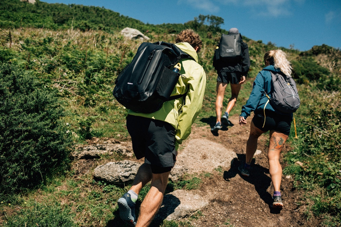 Runners and hikers enjoying the South West Coast Path