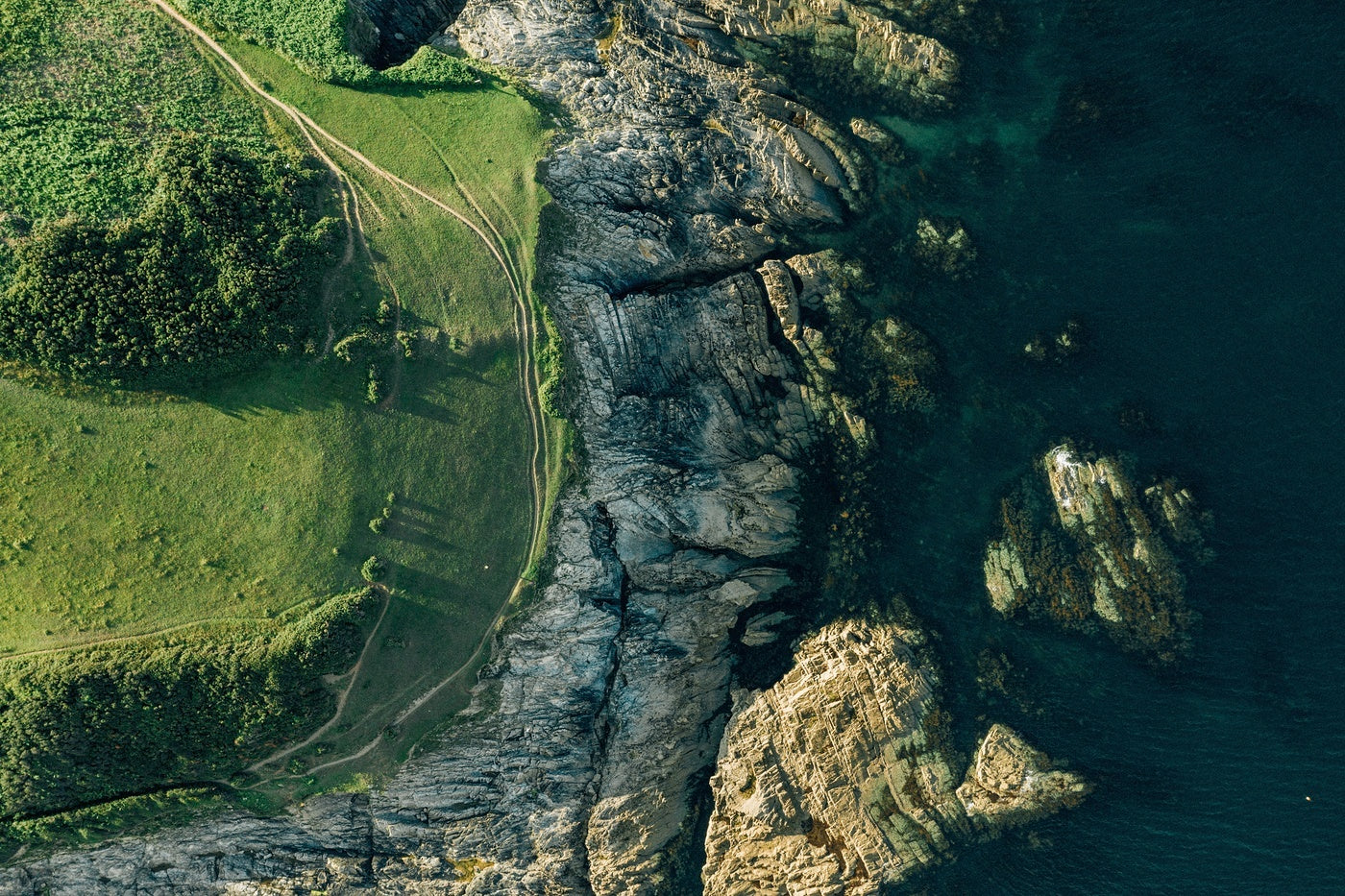 A drone shot of a section of the South West Coast Path on the South coast of Cornwall