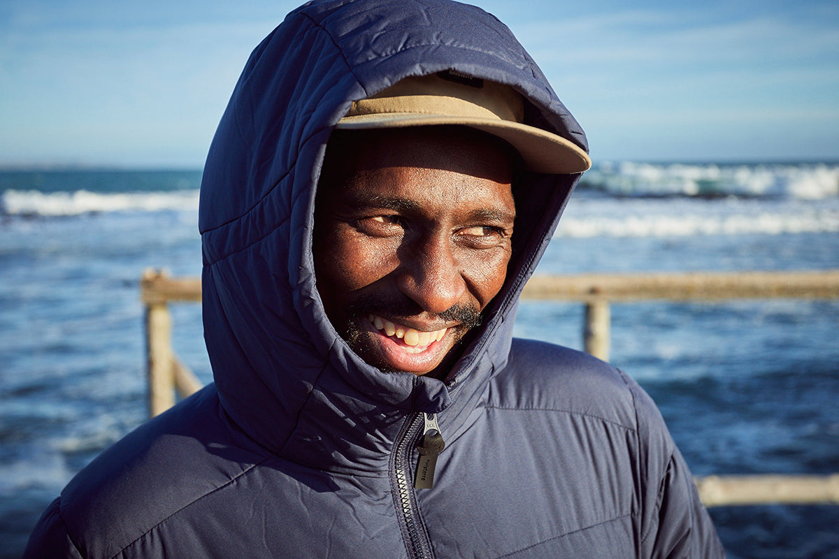 Finisterre Ambassador Apish Tshetsha smiling in the South African winter sun