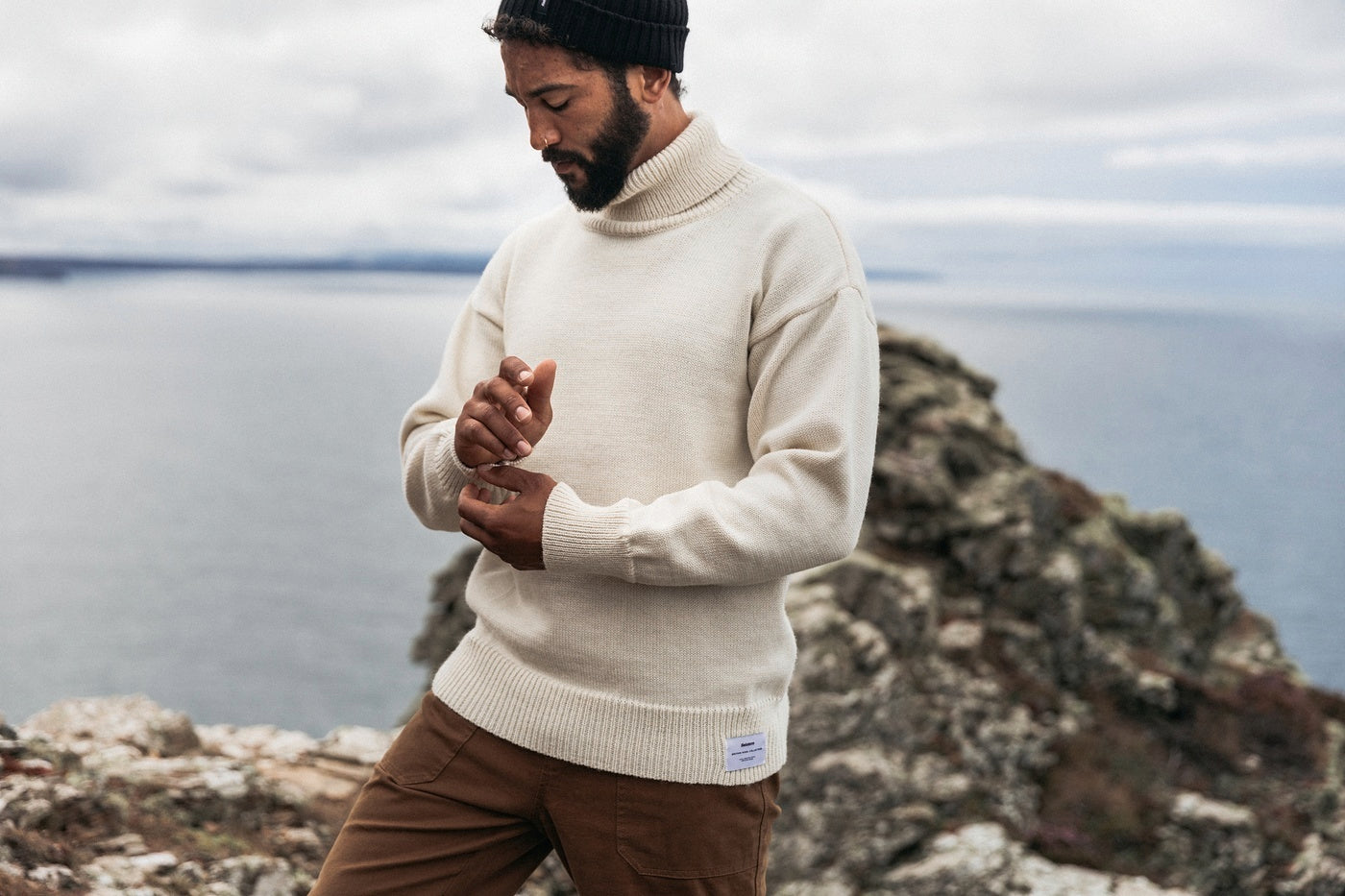 Man wearing the Finisterre Submariner jumper in white