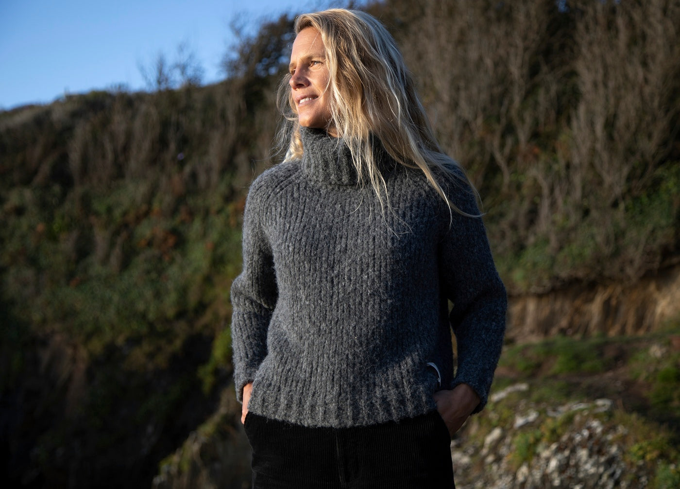 Woman wearing Finisterre Misti Roll neck from the Peruvian Hand Knit collection
