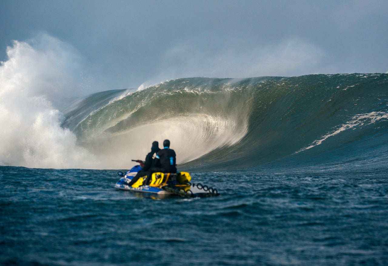 Safety crew watch in awe as a massive wave detonates on the reef
