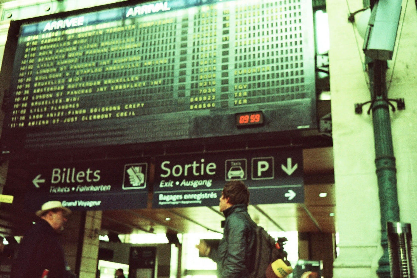 Mat Arney wearing his Finisterre Etobicoke jacket at a French train station