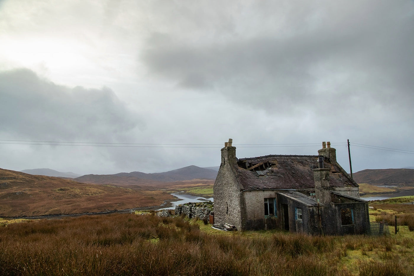 An abandoned dwelling blends into the landscape somewhere on the Isle of Lewis