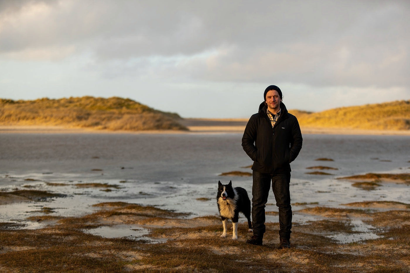 Colin Macleod with his dog on the beach in