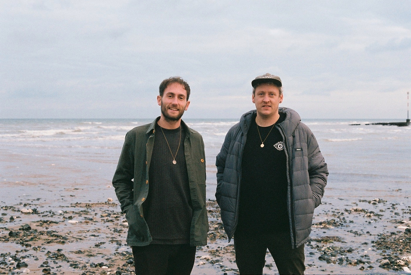 Electronic duo Maribou State wearing Finisterre Jackets by the sea