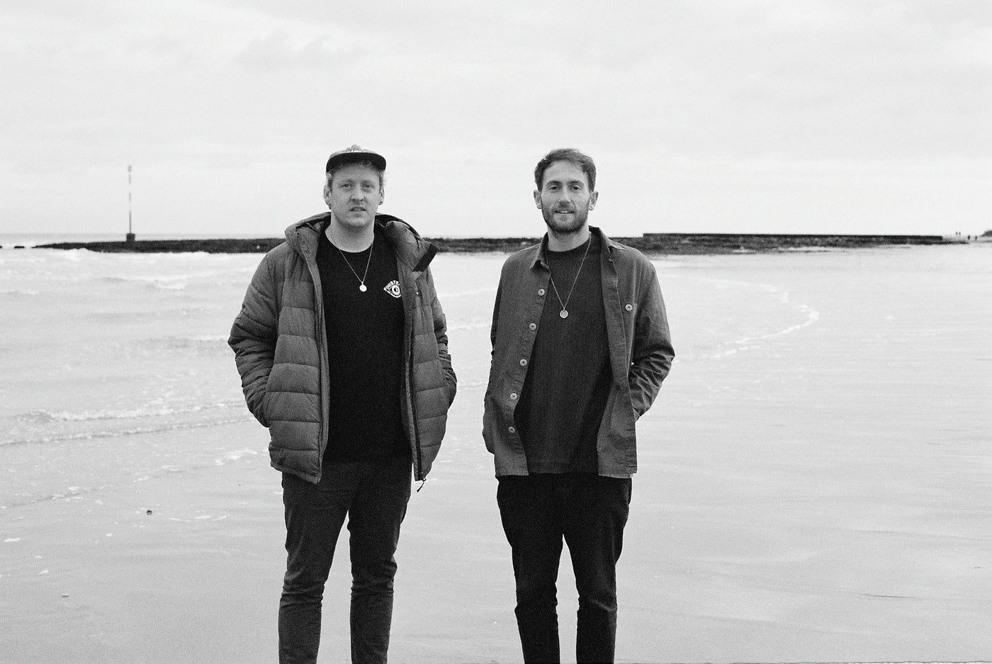 Black and white image of electronic duo Maribou State wearing Finisterre clothing