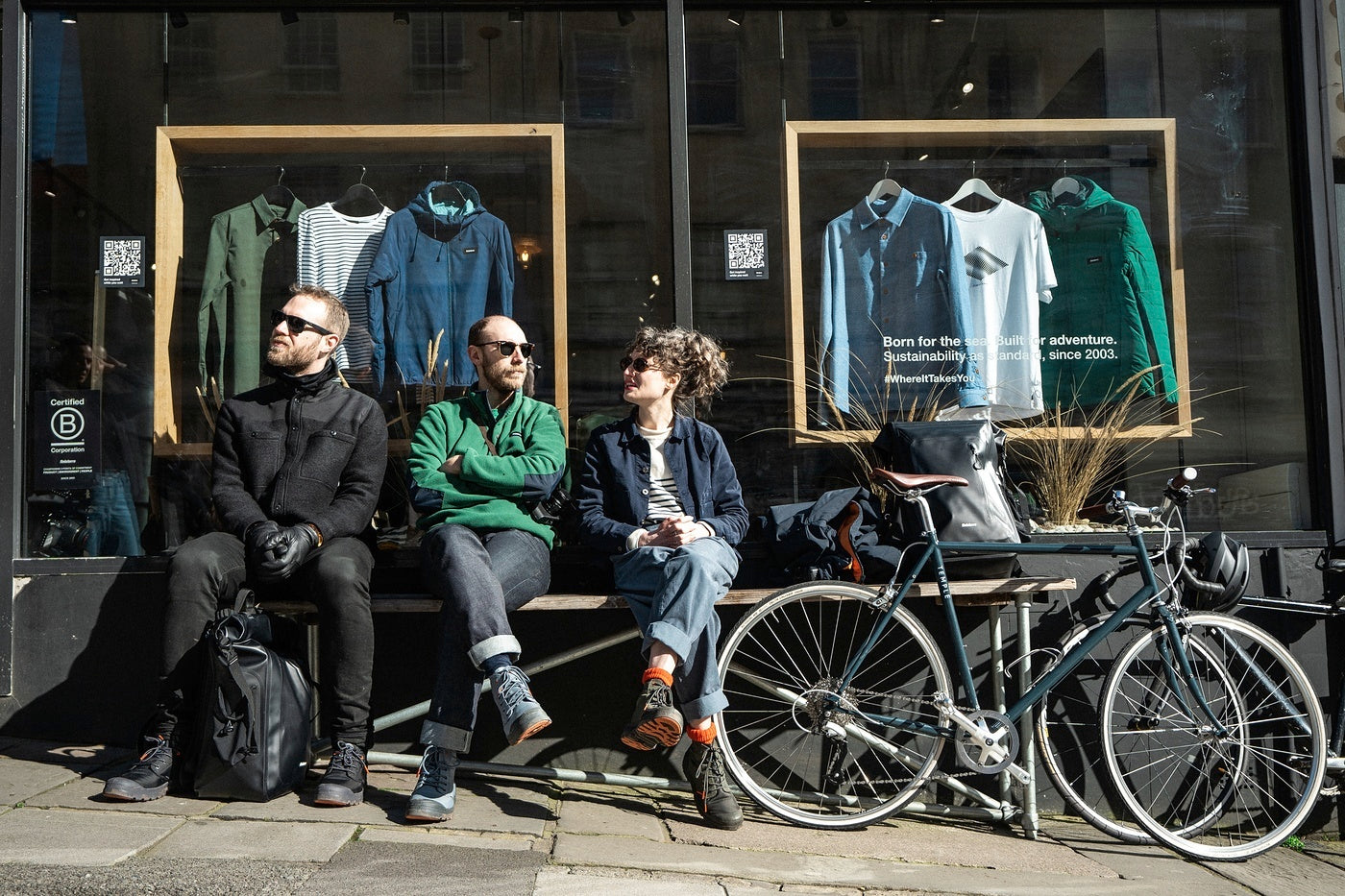Elder Island take a pause from their bike ride outsite the Finisterre store in Bristol