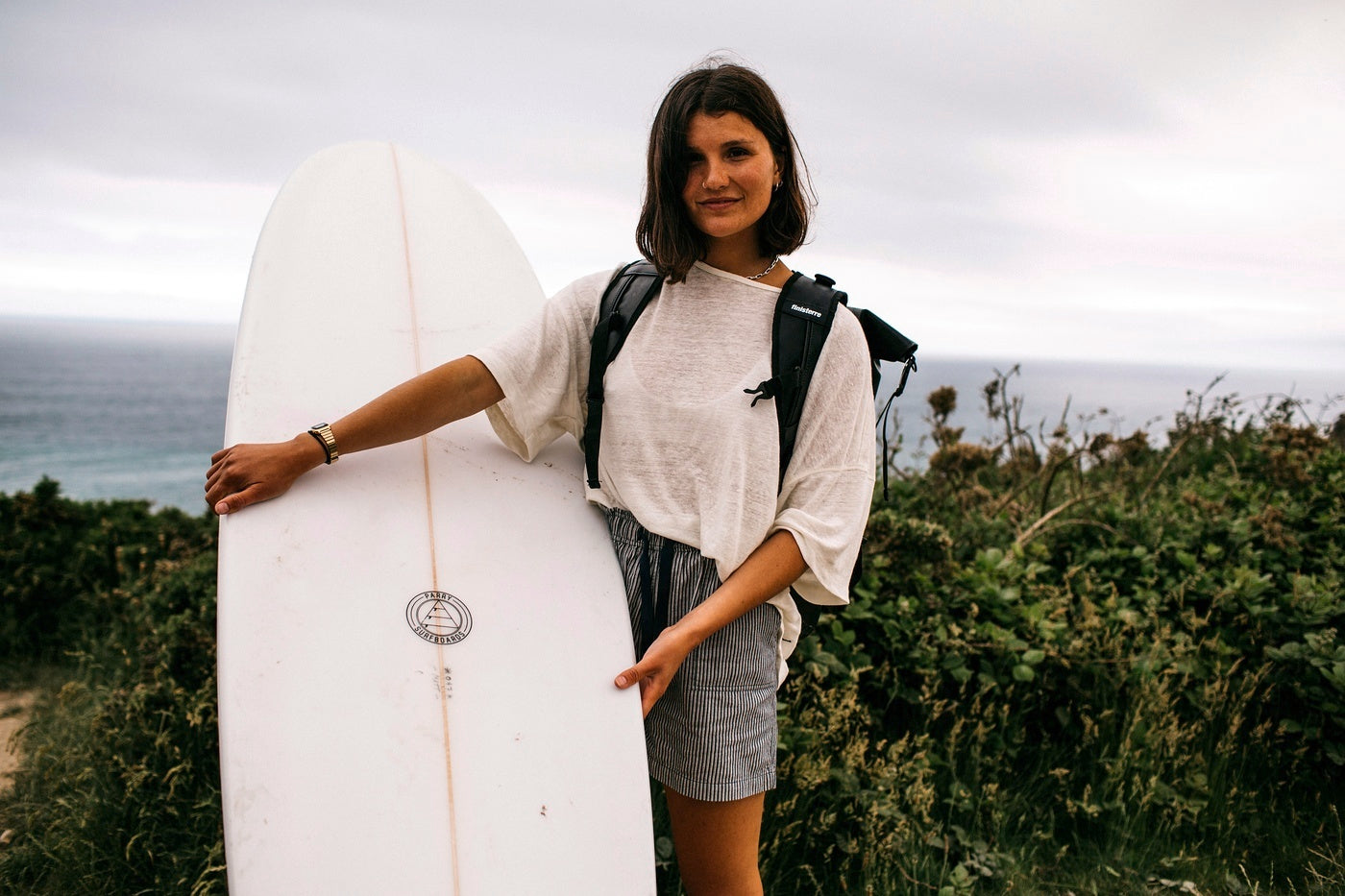 Clara Jonas prepares to head out into the surf with her beloved longboard