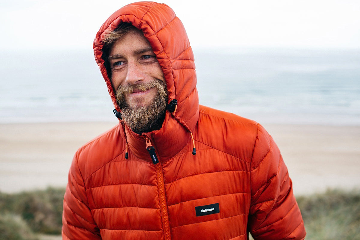 Mike Lay wearing the Nimbus Insulated Jacket in Rust