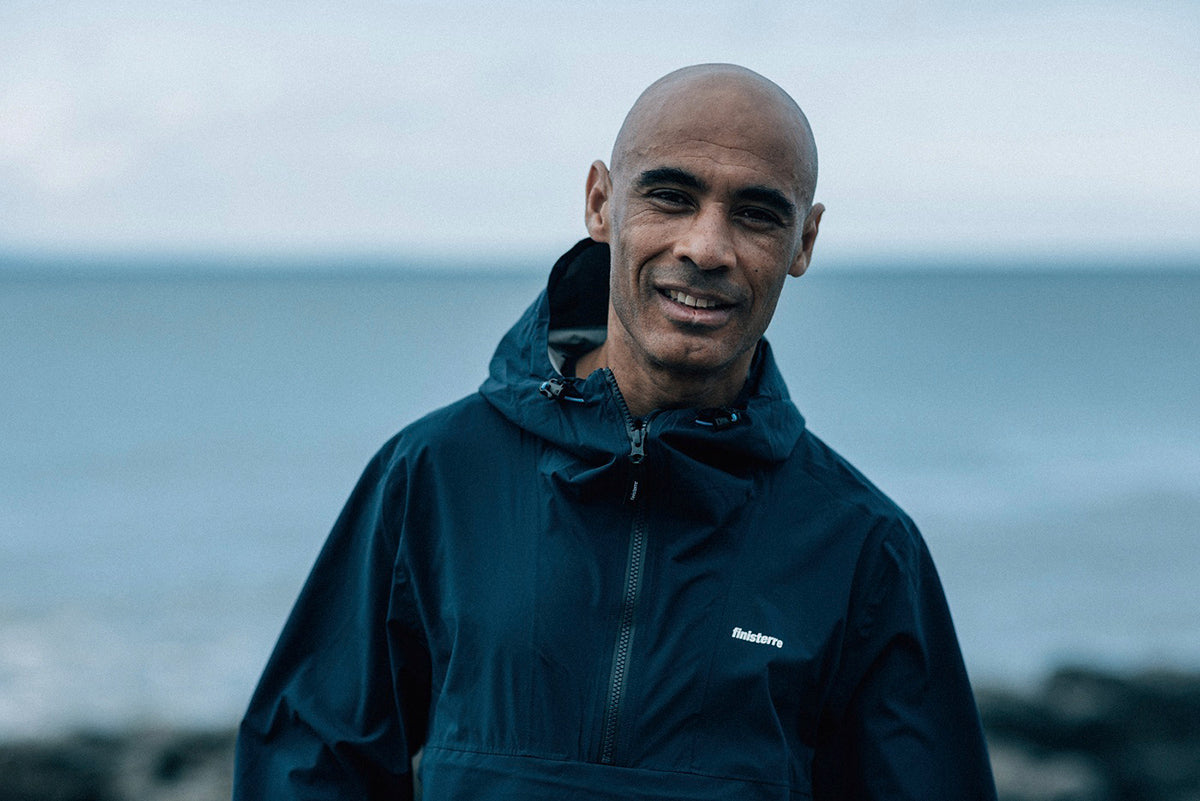 Phil Young wearing the Finisterre Rainbird Waterproof Smock