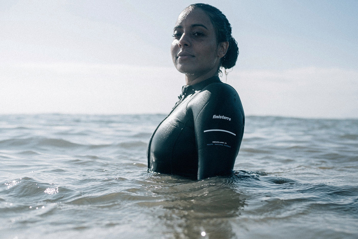 Omie Dale wearing the Finisterre Nieuwland 2e Yulex Swimsuit