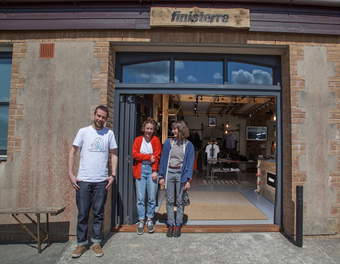 Jasper and the Finisterre St Agnes Store smiling in front of the shop entrance