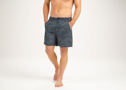 Front of mens blue/white polka dot swim shorts by Finisterre