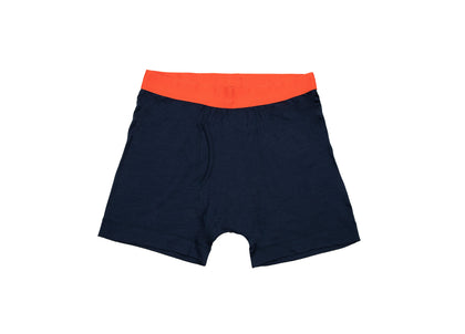 Front of navy merino wool boxers with orange waistband from Finisterre
