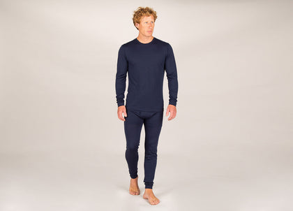 Front of man wearing navy merino wool long johns from Finisterre
