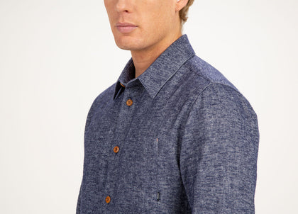 Close up of chest pocket on mens blue, organic cotton/linen shirt by Finisterre