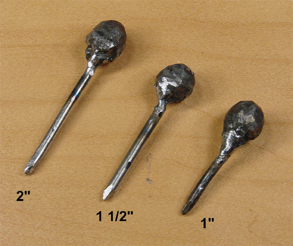 "Clavos Hammered Ball Head 1 1/2"" long nail shank"