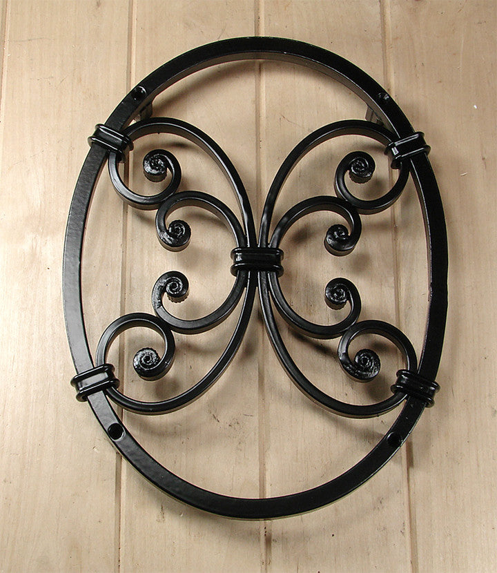 Oval Speakeasy / Window Grille with decorative scroll work