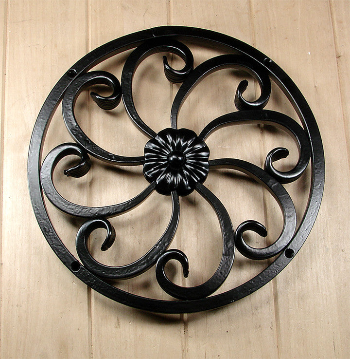 Round Speakeasy / Window Grille / decorative fishtail scroll work / center floral design