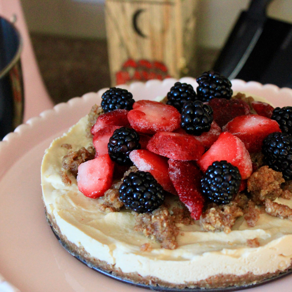 Vegan Meyer Lemon Cheesecake with Pecan & Date Crust with Berry Topping