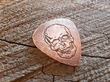 handmade copper guitar pick with skull - playable
