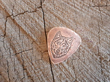 handmade copper guitar pick with wolfs head