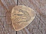 brass guitar pick with snake head - playable