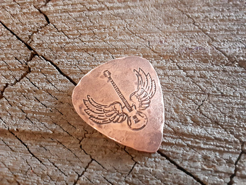 handmade copper guitar pick with winged guitar - playable