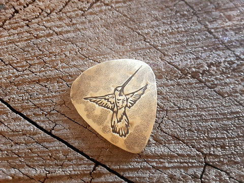 brass guitar pick with hummingbird - playable