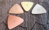 mixed bag of 4 triangular guitar picks in 4 different metals - playable