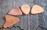 non slip copper guitar picks in 4 different shapes