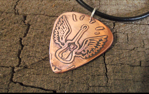 copper guitar pick necklace with winged guitar etched into