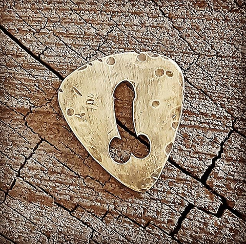 handmade brass dick pick with distressed finish