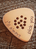 copper guitar pick with holes for improved grip