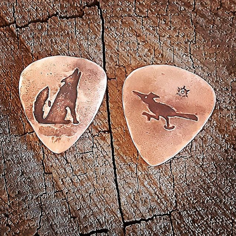 2 playabel copper guitar picks with coyote and roadrunner