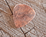 handmade and playable copper pick with music notes