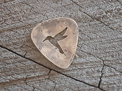 playable bronze guitar pick with hummingbird cut out