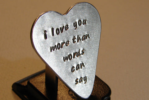 heart shaped guitar pick in sterling silver