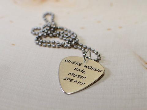 Where words fail music speaks sterling silver guitar pick pendant where words fail music speaks sterling silver guitar pick pendant aloadofball Choice Image