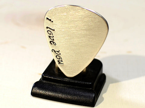 Sterling silver guitar pick with a fancy I love you for Valentines Day