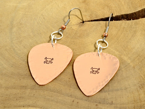 Guitar pick earrings with skulls and crossbones in hammered copper